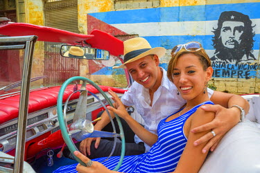 CB01758 Cuba, Havana, La Habana Vieja, Tourists enjoying 1950's classic American Buick (MR)
