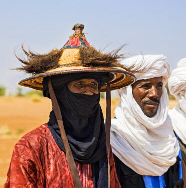 NIG7394 Niger, Agadez, Inebeizguine. Wodaabe men watch a Gerewol ceremony performed by the young men of the tribe.