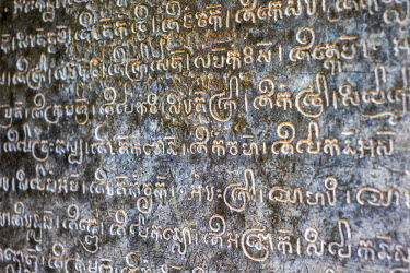 CMB1450AW Khmer writing script carved in stone, Prasat Preah Ko temple ruins, Roluos, UNESCO World Heritage Site, Siem Reap Province, Cambodia