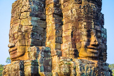 CMB1466AW Carved stone faces at Prasat Bayon temple ruins, Angkor Thom, UNESCO World Heritage Site, Siem Reap Province, Cambodia