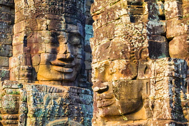 CMB1467AW Carved stone faces at Prasat Bayon temple ruins, Angkor Thom, UNESCO World Heritage Site, Siem Reap Province, Cambodia