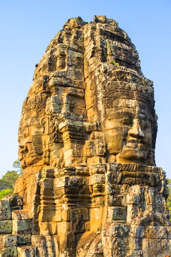 CMB1508AWRF Carved stone faces at Prasat Bayon temple ruins, Angkor Thom, UNESCO World Heritage Site, Siem Reap Province, Cambodia