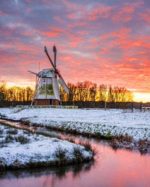 NLD0076AWRF Witte Molen (White Mill) Dutch windmill in winter at sunset, Harn, Groningen, North Holland, Netherlands