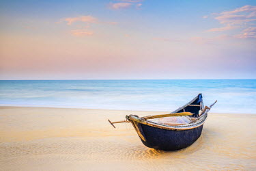 VIT1095AW Traditional bamboo basket fishing boat on the beach at sunset, Thuan An Beach, Phu Vang District, Thua Thien-Hue Province, Vietnam