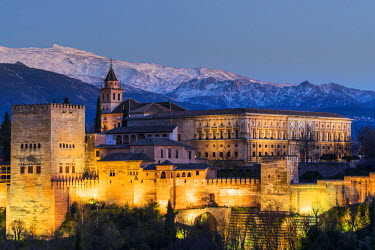 SPA6815AW View at dusk of Alhambra palace with the snowy Sierra Nevada in the background, Granada, Andalusia, Spain