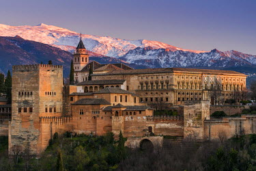 SPA6876AW View at sunset of Alhambra palace with the snowy Sierra Nevada in the background, Granada, Andalusia, Spain