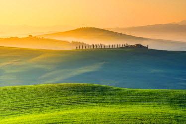 ITA5266AW Valdorcia, Siena, Tuscany, Italy. Rolling hills at sunrise.
