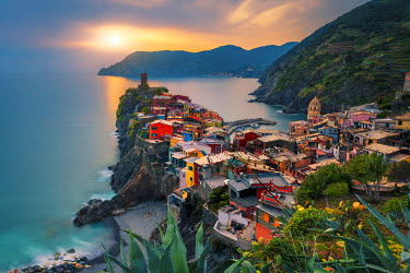 ITA5283AW Vernazza, Cinque Terre, La Spezia, Liguria, Italy. The town and the castle at sunset.