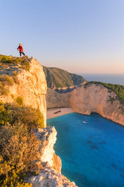 GRE1117AW Woman enjoying sunset over famous shipwreck beach. Zakynthos, Greek Islands, Greece (MR)