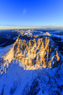 CLKRM28713 Aerial view of Sassolungo Sassopiatto and Grohmann peak at sunset. Dolomites Sella Group Trentino Alto Adige Italy Europe
