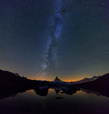 CLKRM33603 Stars and Milky Way above the Matterhorn reflected in Lake Stellisee Zermatt Canton of Valais Switzerland Europe