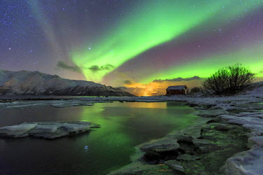 CLKRM36574 The Northern Lights illuminates the icy landscape in Svensby Lyngen Alps Tromsa� Lapland Norway Europe