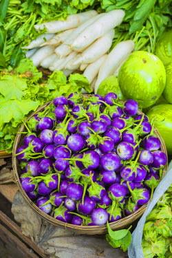 AS06IHO0352 Myanmar. Bagan. Nyaung U. Market. Eggplant for sale in the market.