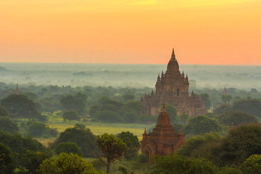 AS06IHO0390 Myanmar. Bagan. Smoke from cooking fires shrouds the temples of Bagan at sunrise.