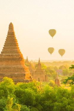 AS06IHO0394 Myanmar. Bagan. Hot air balloons rising over the temples of Bagan.