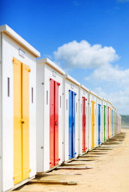 ENG12932AW England, North Devon, Woolacombe. Brightly coloured beach huts at Woolacombe.