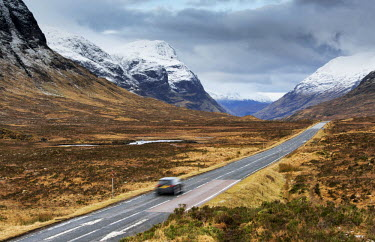 SCO33885AW Scotland, Glencoe. The A82 road passing snow capped mountains in winter.