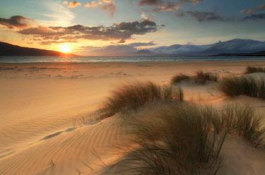 SCO33917AW Scotland, Isle of Harris. The dunes of Luskentyre Bay at sunset.