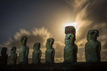 CHI9010AW South America, Chile, Easter Island, Isla de Pascua, Moai stone human figures under a  night sky at moonrise