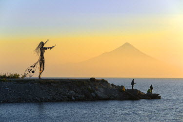 CHI9022AW South America, Chile, Lake District, Patagonia, Puerto Varas, Osorno volcano, fishermen at dawn on Lago Llanquihue