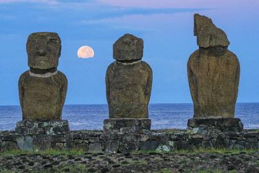 CHI9052AWRF South America, Chile, Easter Island, Isla de Pascua, Moai stone human figures under a  night sky at moonrise