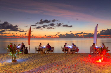MIV0301AW People dining on beach at Olhuveli Beach and Spa Resort at sunset, South Male Atoll, Kaafu Atoll, Maldives (PR)