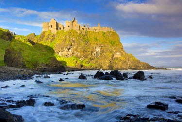 EU15BJN0090 Sunrise over Dunluce Castle along northern coast of County Antrim, Northern Ireland, UK