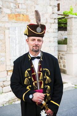 MNT0009AW Montenegro, Kotor Bay, Perast, Local man in traditional dress
