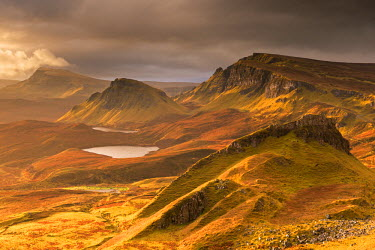 SCO33983AW Dramatic light over the Trotternish mountain ridge from the Quiraing, Isle of Skye, Scotland.