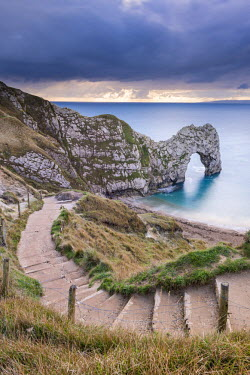 ENG13195AW Steps leading down to Durdle Door on the Jurassic Coast, Dorset, England. Autumn (November) 2014.