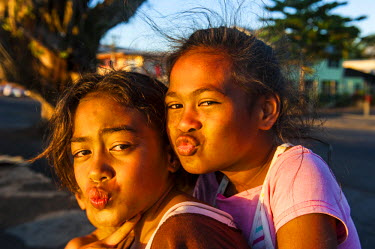 OC08MRU0136 Young girls posing as western actors, Apia, Upolu, Samoa, South Pacific
