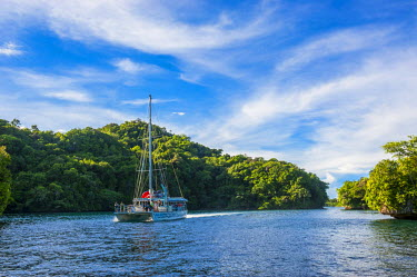 OC16MRU0105 Sailboat leaving the harbor of Koror, Rock Islands, Palau, Central Pacific