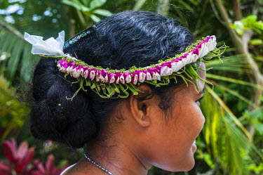 OC18MRU0174 Young girl with flowers in her hair, Island of Yap, Micronesia