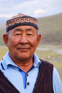 AS25EWI0109 Asia, Western Mongolia, Mongolian man wearing traditional hat