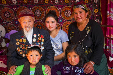 AS25EWI0142 Asia, Western Mongolia, Bayan-Olgii. Suhayt, inside a yurt or Ger, nomad's, multi-generational family. Grandfather is more than 90 years old