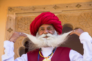 AS10EWI0262 Asia, India, Rajasthan, Udaipur. Man with white mustache and long white beard dressed in red