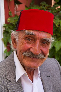 AS37EWI0157 Turkey, Istanbul. Turkish elderly man with red Fez hat. The tarboosh and the modern fez, which is similar, owes much of its development and popularity to the Ottoman era