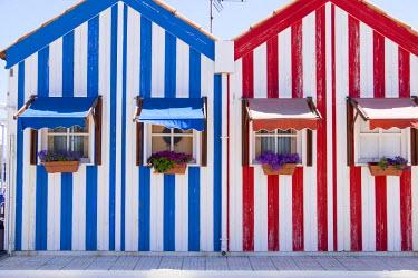 EU23EWI0396 Portugal, Costa Nova, seaside, fisherman's village with stripped, decorated houses, which line the main promenade.
