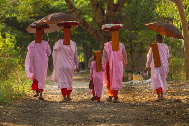 AS06BJY0007 Myanmar, Mandalay. Buddhist nuns walking down road