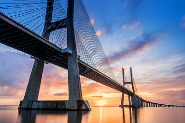 POR8774AW Lisbon, Portugal. Vasco Da Gama bridge at sunrise, the longest bridge in Europe.