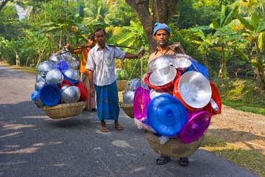 AS03MRU0041 Man carrying lots of steel pots, Bangladesh, Asia