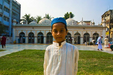 AS03MRU0119 Young Muslim boy before the Sitara Mosque, Dhaka, Bangladesh, Asia