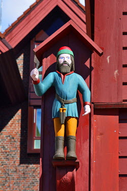 NOR0796AW Wooden statue of St Jack on a wooden house facade. Warehouse in the Bryggen District, a former counter of the Hanseatic League. A UNESCO World Heritage Site, Bergen. Norway