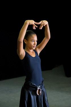 CA11JME0074 Cuba, Havana, girl practicing at ballet and folkloric dance school