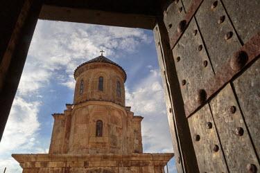 AS08ALA0376 Georgia, Kutaisi. Gelati Monastery framed by a door from a neighboring building.