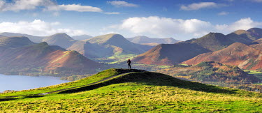 ENG13289AW England, Cumbria, Keswick. A hiker with a panoramic view of the Western Fells. MR.