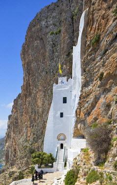 GRE1205AW Greece, Cyclades, Amorgos. Greek Orthodox Priest and friends leaving the Monastery of Panagia Hozoviotissa.