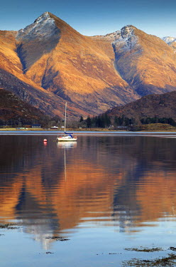 SCO34077AW Scotland, Highland. A boat and the mountains of Kintail reflected in Loch Duich.