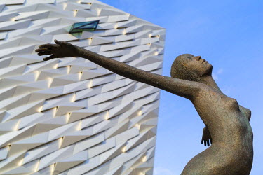NIR8866AW United Kingdom, Northern Ireland, County Antrim, Belfast. Titanica, a sculpture by Rowan Gillespie. Located on Queen's Island in the Titanic Quarter, Titanic Belfast stands on the site of the former H...
