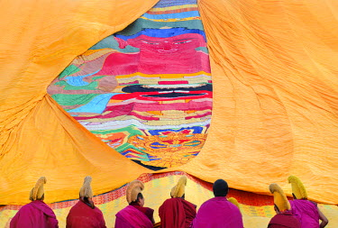 HMS0909650 China, Gansu Province, Amdo, Xiahe, Monastery of Labrang (Labuleng Si), Losar (New Year festival), Furling of the giant Thangka